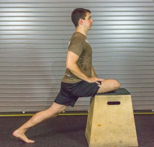 pigeon stretch elevated on box squat deep mobility